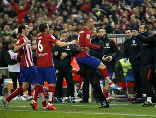 Atletico Madrid's Antoine Griezmann celebrates his goal with coach Diego Simeone