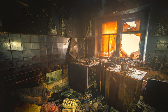 Interior of a burnt by fire apartment in an apartment building, burned furniture