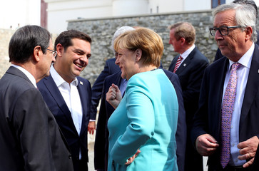 Germany's Chancellor Merkel talks with Greek Prime Minister Tsipras during a family photo at the European Union summit - the first one since Britain voted to quit - in Bratislava