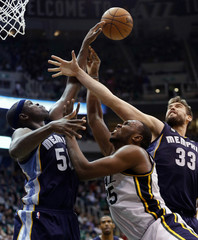 Utah Jazz Jefferson is defended on a shot by Memphis Grizzlies Randolph and Gasol during their NBA game in Salt Lake City, Utah