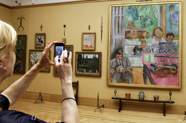 "Member of media takes photograph of Matisse's ""The Music Lesson"" in gallery 19 during media opening of new Barnes Foundation Museum in Philadelphia"