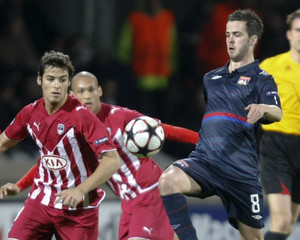 Olympique Lyon's Pjanic challenges Gourcuff of Girondins Bordeaux during their Champions League quarter-final first leg soccer match at the Gerland stadium