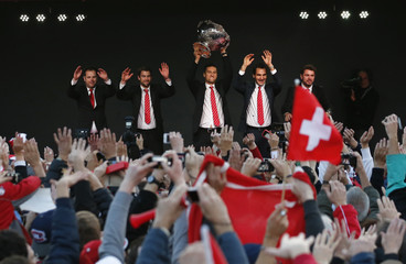 Switzerland's Davis Cup tennis team members celebrate with the Davis Cup trophy during a ceremony in Lausanne