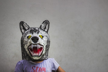 Kid with carton wolf mask
