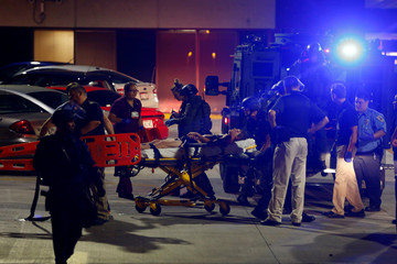 A man shot during disturbances following a police shooting is taken into a hospital in Milwaukee, Wisconsin