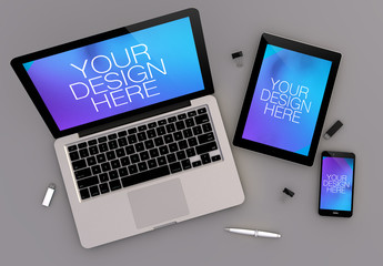 Top View Mockup of Devices and Computer on Gray Background