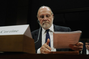 Corzine collects his notes during a break in his testimony before a House Financial Services Committee Oversight and Investigations Subcommittee hearing on the collapse of MF Global, at the U.S. Capitol in Washington