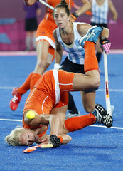 Netherlands' Goderie falls on ground next to Argentina's D'elia during their women's gold medal hockey match at Riverbank Arena at London 2012 Olympic Games