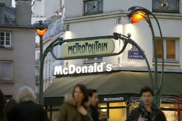 A McDonalds fast food restaurant is seen near the entrance of a Metro station in Paris