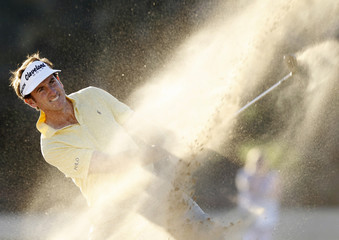 Fernandez-Castano of Spain hits out of a bunker at the 18th green during the second round of the Abu Dhabi Golf Championship at the Abu Dhabi Golf Club