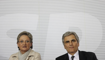 Austrian Education Minister Schmied and Chancellor Faymann address a news conference in Vienna