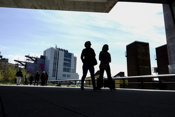 People walk on the High Line near the new Whitney Museum of American Art in New York