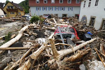 Damaged cars are pictured amid debris after floods in the town of Braunsbach