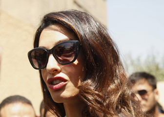 Amal Clooney talks to the media after the verdict outside a court in Cairo