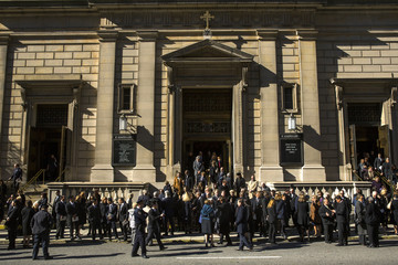 Mourners file out of Church of St. Ignatius Loyola following  memorial service for de la Renta in New York