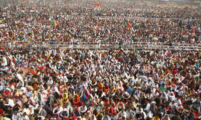 Supporters of BJP attend a rally being addressed by Hindu nationalist Narendra Modi at Guwahati