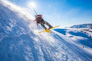 Fototapete - Skiing in the snowy mountains, Carpathians, Ukraine, good winter day, ski jump, fall, ski season