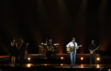 """Jon Lilygreen and The Islanders from Cyprus perform their song """"Life Looks Better In Spring? during a dress rehearsal for the finals of the Eurovision Song Contest in Oslo"""