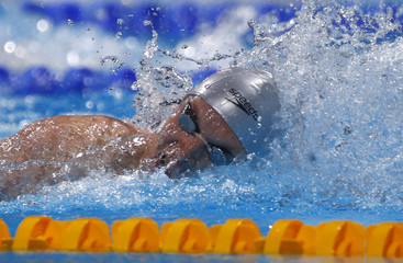 Derlyugov of Uzbekistan competes in men's 200m individual medley heats during the World Swimming Championships in Barcelona