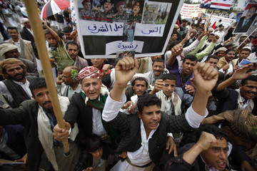 Supporters of Yemen's President Saleh shout slogans during a rally in Sanaa