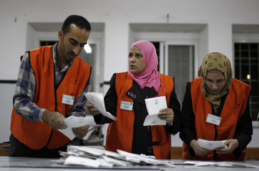 Officials count ballots after the polls  closed for municipal elections at a polling station in the West Bank city of Hebron