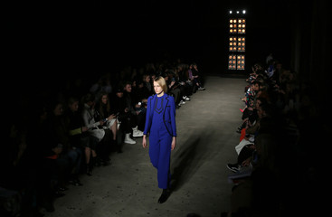 A model presents a creationsat the Osman catwalk show at London Fashion Week Autumn/Winter 2016 in London, Britain
