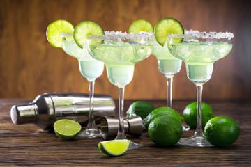 Bartending shaker and four Margaritas
