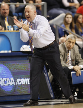 Marquette University head coach Buzz Williams reacts against Butler University during NCAA basketball game in Lexington