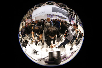 Journalists photograph the new attachable Sony lens G for smartphones at the booth of Sony on the IFA consumer electronics fair in Berlin