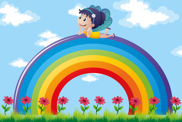 Fairy relaxing on colorful rainbow