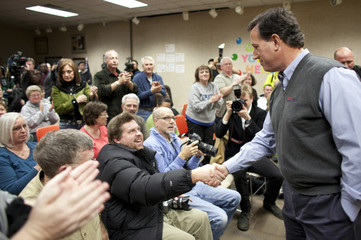 Republican presidential candidate Santorum greets supporters in Indianola
