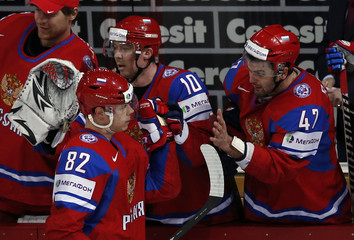 Russia's Medvedev high-fives Radulov and Mozyakin after scoring against Latvia during their 2013 IIHF Ice Hockey World Championship preliminary round match at the Hartwall Arena in Helsinki