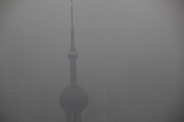 A view from the Shanghai World Financial Centre building shows the Oriental Pearl TV Tower on a hazy day in Shanghai