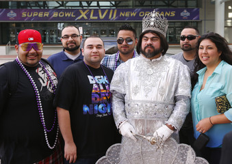 Ray Olea, the king of the group from the Sparta parade poses for pictures before the start of Mardi Gras 2013 celebration in New Orleans