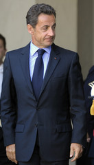 France's President Nicolas Sarkozy watches as Kazakhstan President Nursultan Nazarbayev leaves the Elysee Palace in Paris