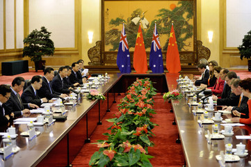 Chinese President Xi attends a meeting with Australian PM Abbott at the Great Hall of the People in Beijing