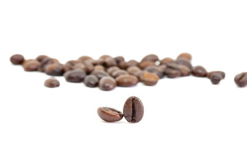 Roasted coffee beans and solated on a white background.