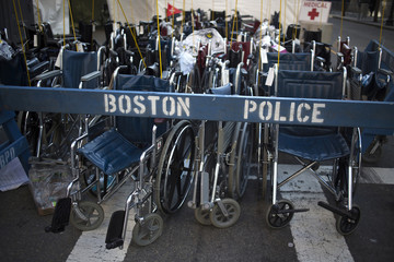 Wheel chairs are seen behind a Boston police barricade near the finish line in Boston, Massachusetts