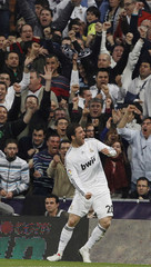 Real Madrid's Gonzalo Higuain celebrates his goal during their Spanish first division match against Atletico Madrid at the Santiago Bernabeu stadium in Madrid