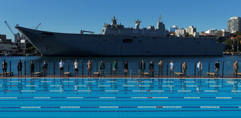 """Australia's naval ship HMAS Canberra forms a backdrop as Sydney's Andrew """"Boy"""" Charlton swimming pool hosts a men's fashion show for the Katama label by American designer Garrett Neff during Fashion Week Australia Sydney in Sydney"""