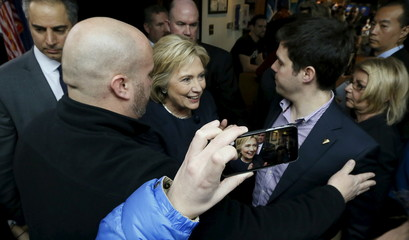 Clinton works her way through the crowd during a campaign stop at the Adel Family Fun Center bowling alley in Adel, Iowa