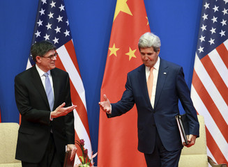 U.S. Treasury Secretary Lew talks with U.S. Secretary of State Kerry at the opening ceremony of the Sixth Round of U.S.-China Strategic and Economic Dialogue in Beijing