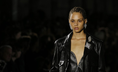 A model presents a creation by designer Anthony Vaccarello as part of his Spring/Summer 2017 women's ready-to-wear collection for fashion house Saint Laurent during Fashion Week in Paris