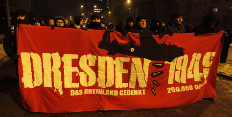 Right wing supporters walk through the city of Dresden to mark the 67th anniversary of the city's air raids