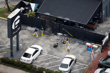 FBI officials collect evidence from Pulse gay night club parking lot some days after mass shooting in Orlando
