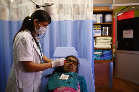 Manjura Budhathoki has her hair shaved before laser hair removal treatment at Dhulikhel Hospital in Kavre