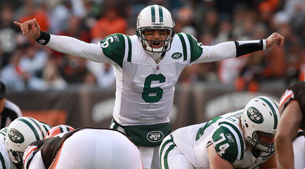 New York Jets' Sanchez makes a play call at the line of scrimage during overtime in Cleveland