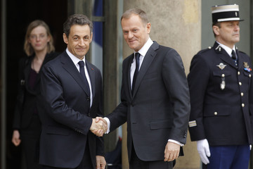 France's President Sarkozy greets Polish Prime Minister Tusk at the Elysee Palace ahead of international talks on Libya in Paris