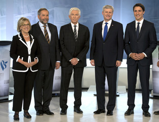 Green party Leader Elizabeth May, NDP Leader Tom Mulcair, Bloc Quebecois Leader Gilles Duceppe, Conservative Leader Stephen Harper, and Liberal Leader Justin Trudeau pose for photos before the French-language leaders' debate in Montreal