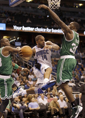 Orlando Magic Nelson pitches out around Boston Celtics Pietrus and Bass during the second half of their NBA basketball game in Orlando